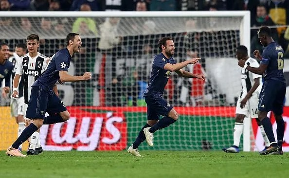 Juan Mata wheels away to celebrate his late equaliser, but there was more to come...