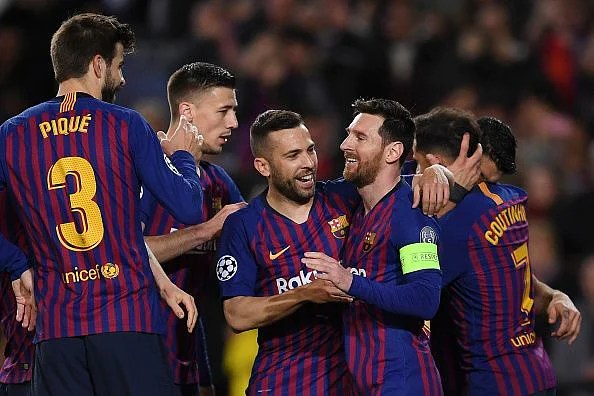 Messi celebrates with his teammates during their 5-1 win over Lyon in the second leg tie