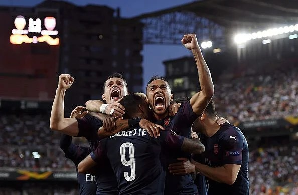 Arsenal players celebrate one of their goals during their Europa League semi-final win over Valencia