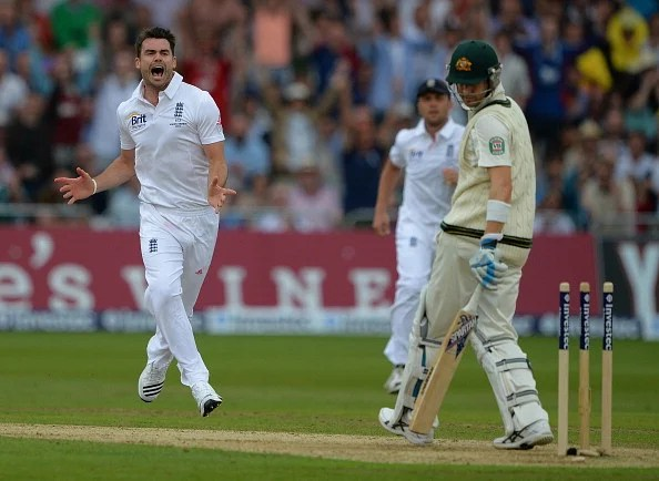 England's James Anderson (L) celebrates after bowling Australia's Michael Clarke (R) during the first Ashes cricket test match between England and Australia at Trent Bridge in Nottingham, central England on July 10.