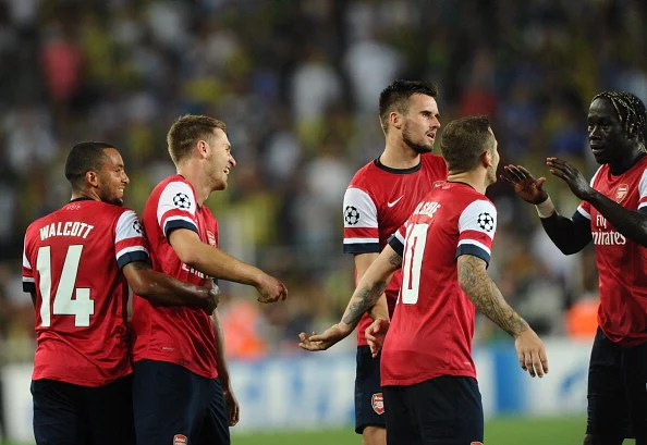 Arsenal's Aaron Ramsey (2L) celebrates with teammates after scoring the second goal against Fenerbahce during their UEFA Champions League Play Off first leg match at Sukru Saracoglu Stadium in Istanbul on August 21, 2013. (Getty Images)
