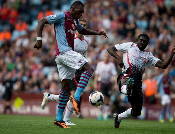 Christian Benteke of Aston Villa is challenged by Kolo Toure of Liverpool
