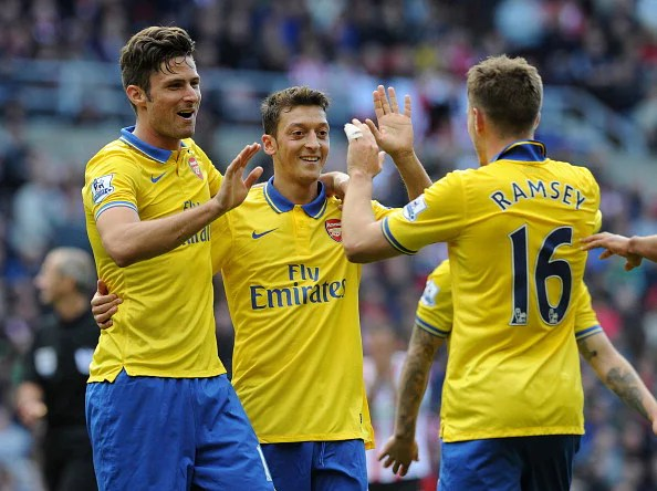 Aaron Ramsey celebrates scoring Arsenal's third goal (his second) with Olivier Giroud and Mesut Oezil during the Barclays Premier League match between Sunderland and Arsenal at Stadium of Light on September 14, 2013 in Sunderland, England.  (Getty Images)