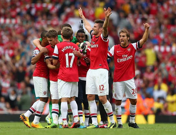 Arsenal celebrate their victory in the North London Derby at the Emirates
