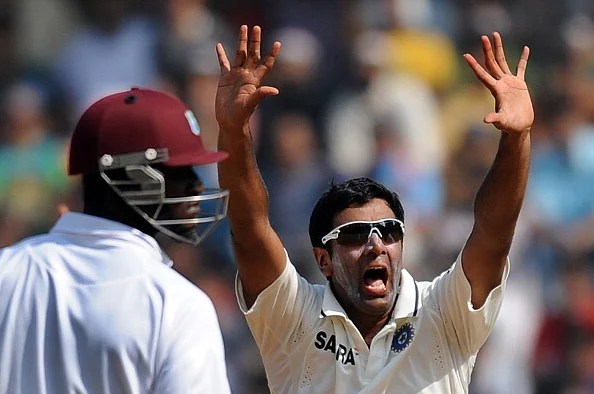Darren Sammy (L) looks on as Ashwin (R) celebrates taking the wicket of Kieran Powell during fifth day of the third Test between India and the West Indies at The Wankhede stadium in Mumbai on November 26, 2011. (Getty Images)