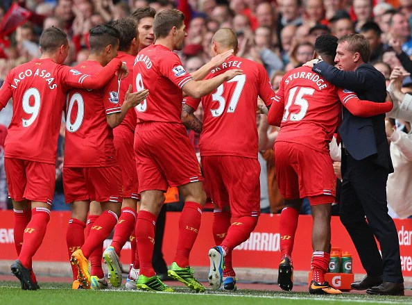 Liverpool players celebrate alongside manager Brendan Rodgers.