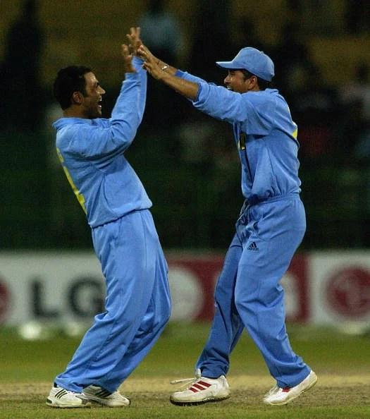 Virender Sehwag and Sachin Tendulkar of India celebrate a wicket