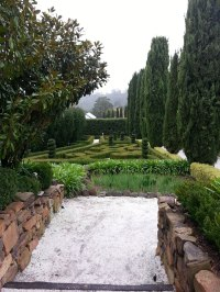 A Secret Garden.topiary, hedges, gravel and stone walls ...