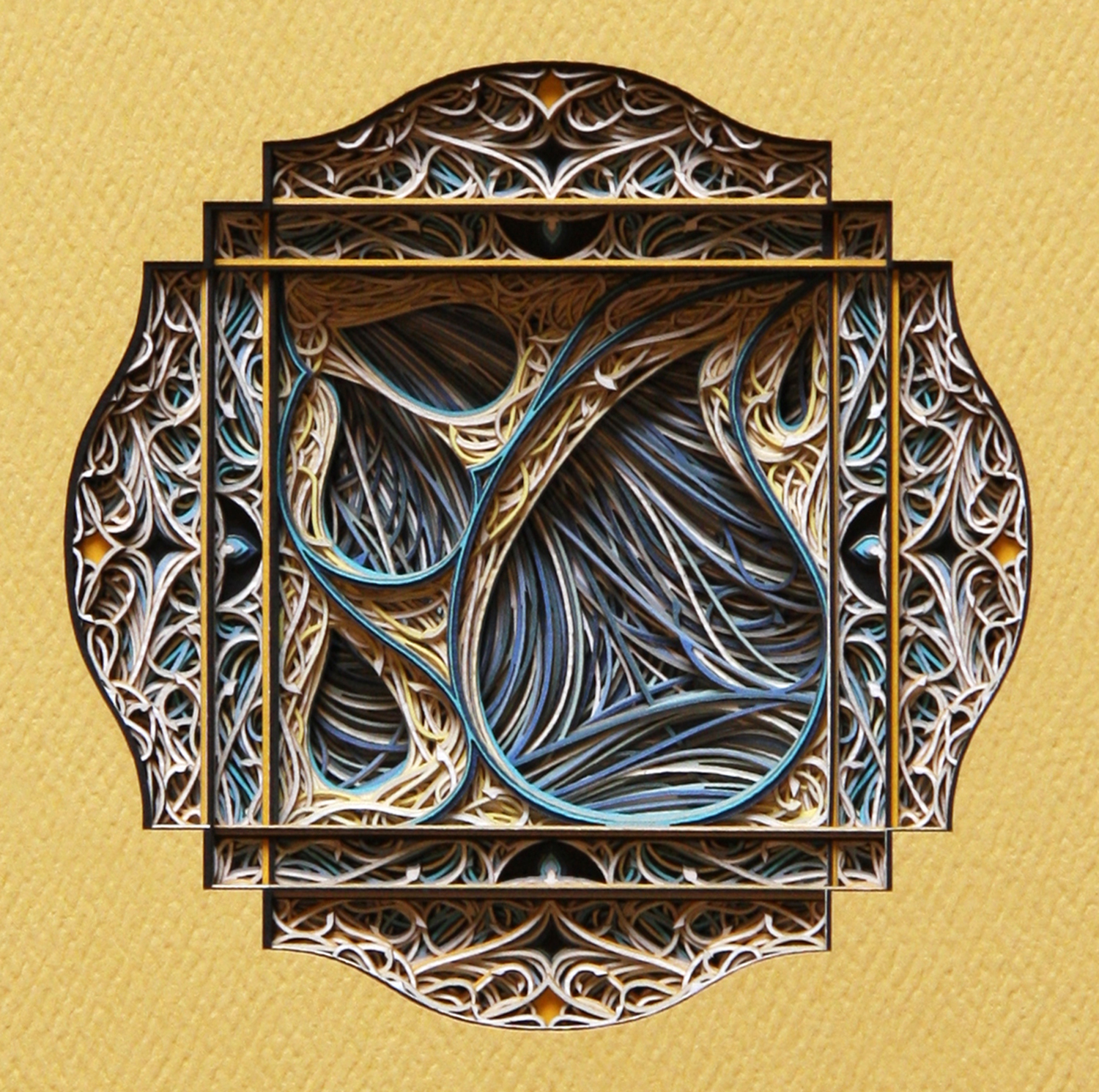 An ornate, window-style ornamentation made from layered paper