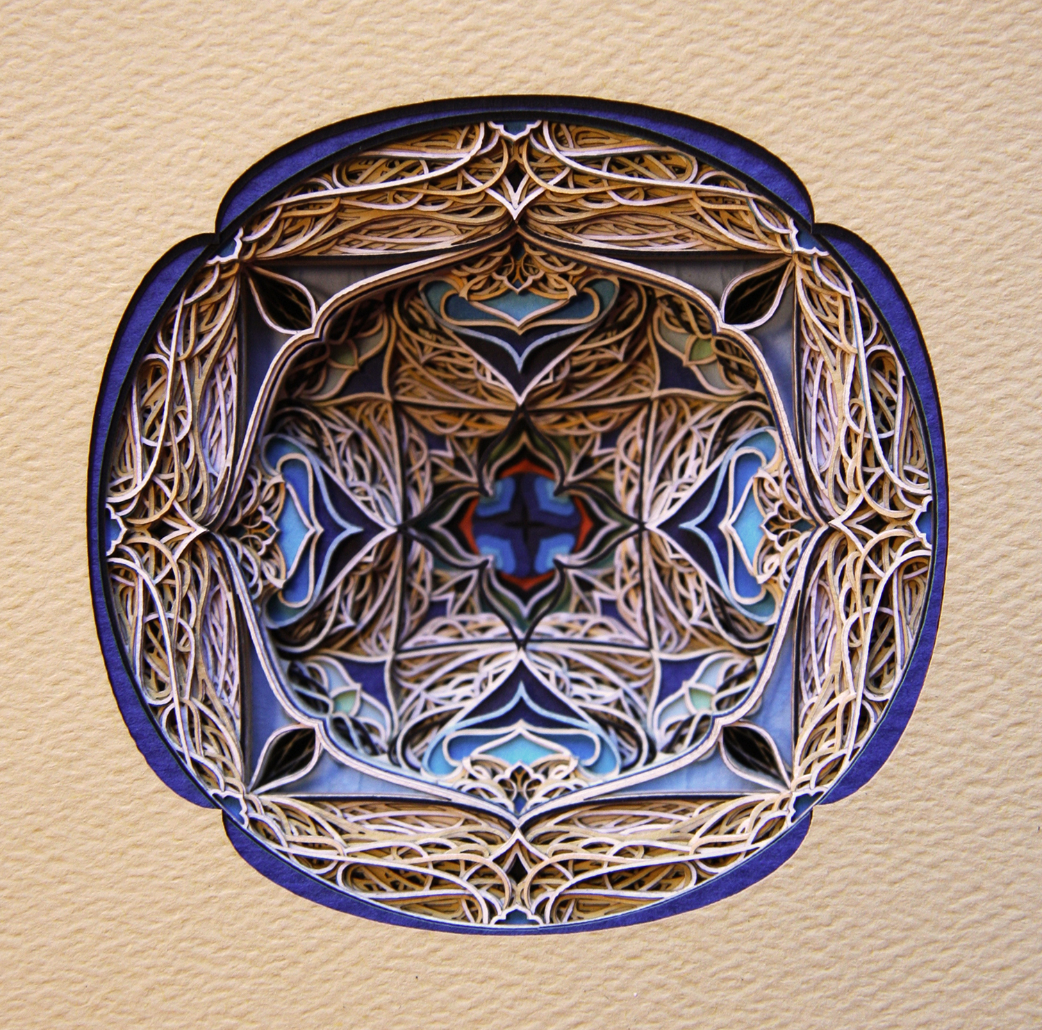 Ornate window-style ornamentation made of cut paper
