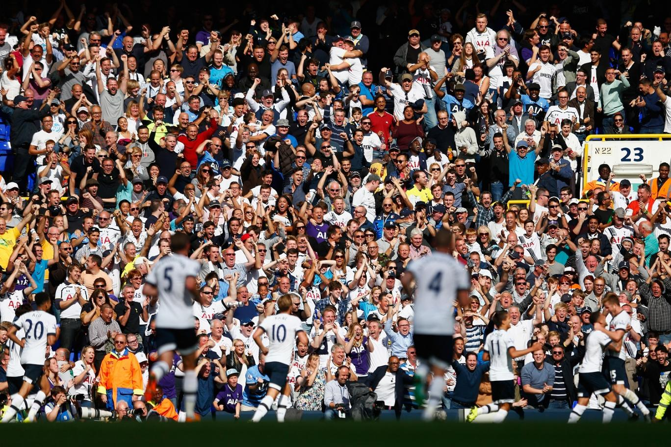 They don't care: Tottenham celebrate after Harry Kane scores his first league goal of the season Getty