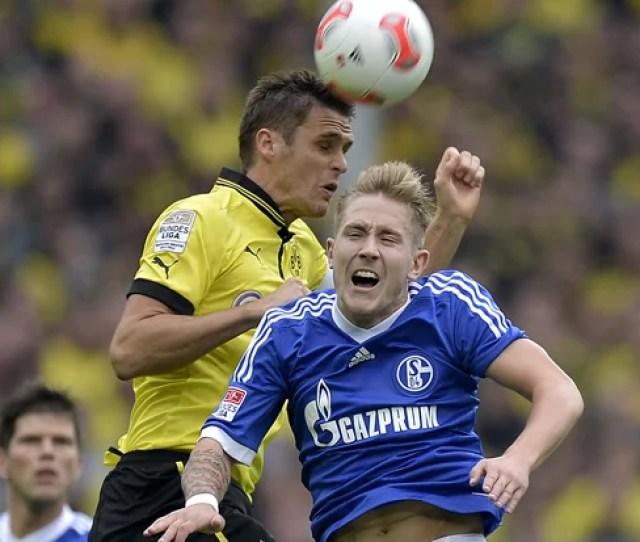 Dortmunds Sebastian Kehl Left And Schalkes Lewis Holtby