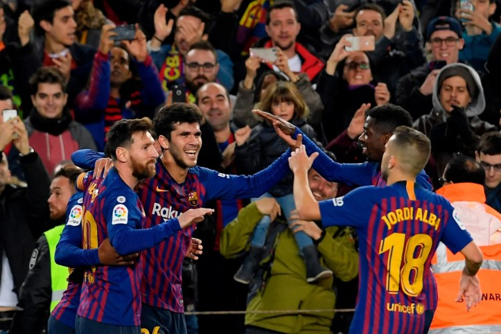 On target: Carles Alena celebrates his late goal with team-mates