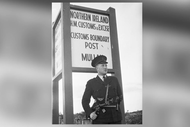 Hard border: A Royal Ulster Constabulary officer stands guard  at a customs post in 1961
