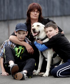 DIFFICULT STRUGGLE: Vanessa O'Sullivan with her two sons, James, 9, and Trent, 12. The boys are autistic and James also has intellectual disabilities and needs more teacher aide hours to learn at school. Mrs O'Sullivan raised $10,000 to get James an assistance dog called Andy.