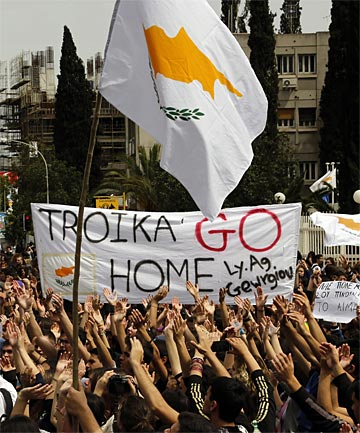 WIDESPREAD ANGER: Students hold Greek and Cypriot flags and shout slogans as they take part in a protest outside the Presidential palace in Nicosia, photo: Reuters