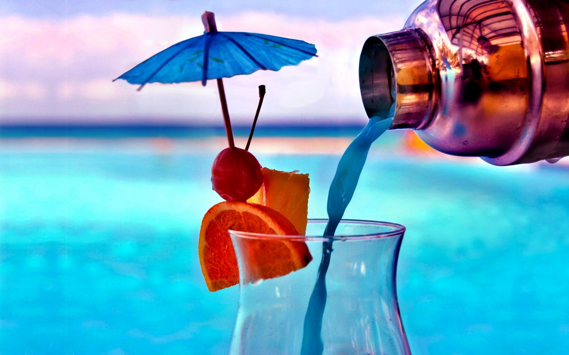 delicious cocktail in a summer hot night - pool party