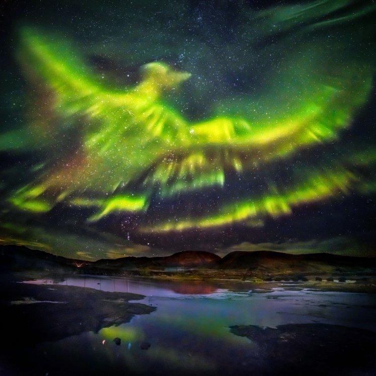 A fotografia impressionante de uma aurora boreal em forma de