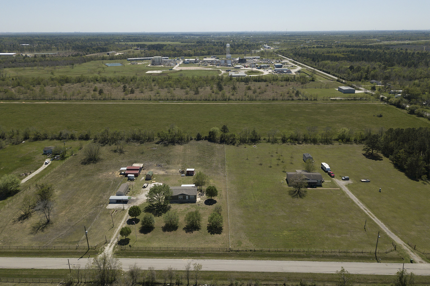 Homes in view of the Arkema chemical plant in Crosby, Texas.