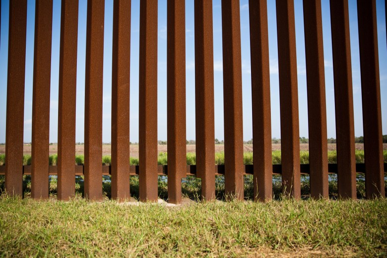 """A small opening at the base of the border fence in Brownsville is meant to let small, endangered wild cats like the ocelot through. The """"cat holes,"""" which are the size of a piece of printer paper, appear every 500 feet or so."""