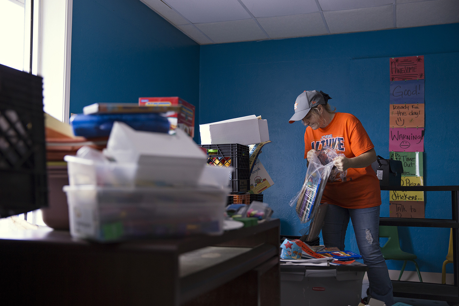 Anna Lingo sorts through salvaged items from the James Hope Center after it was flooded during Hurricane Harvey.