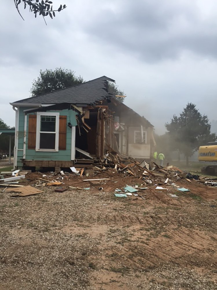 Randa Langerud's Wharton home being demolished due to damage sustained from Hurricane Harvey. Langerud's home was the first of 10 to be torn down in her neighborhood.