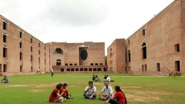 Students sitting in the campus lawns of IIM Ahmedabad | Facebook