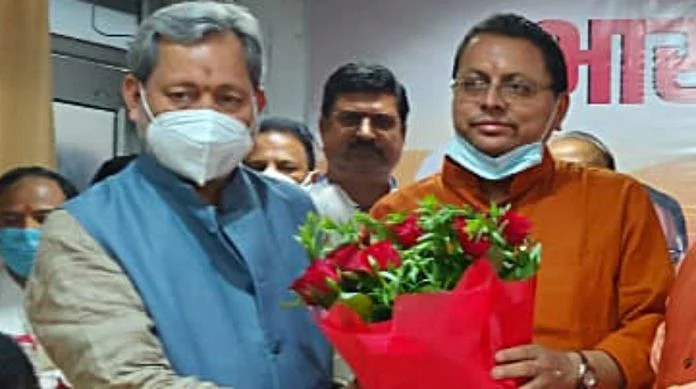 Outgoing Uttarakhand Chief Minister Tirath Singh with newly elected chief minister Pushkar Singh Dhami in Dehradun on Saturday   ANI