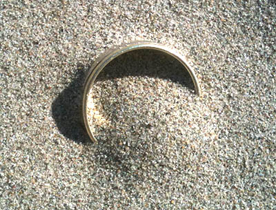 Lost wedding ring hidden in the sand