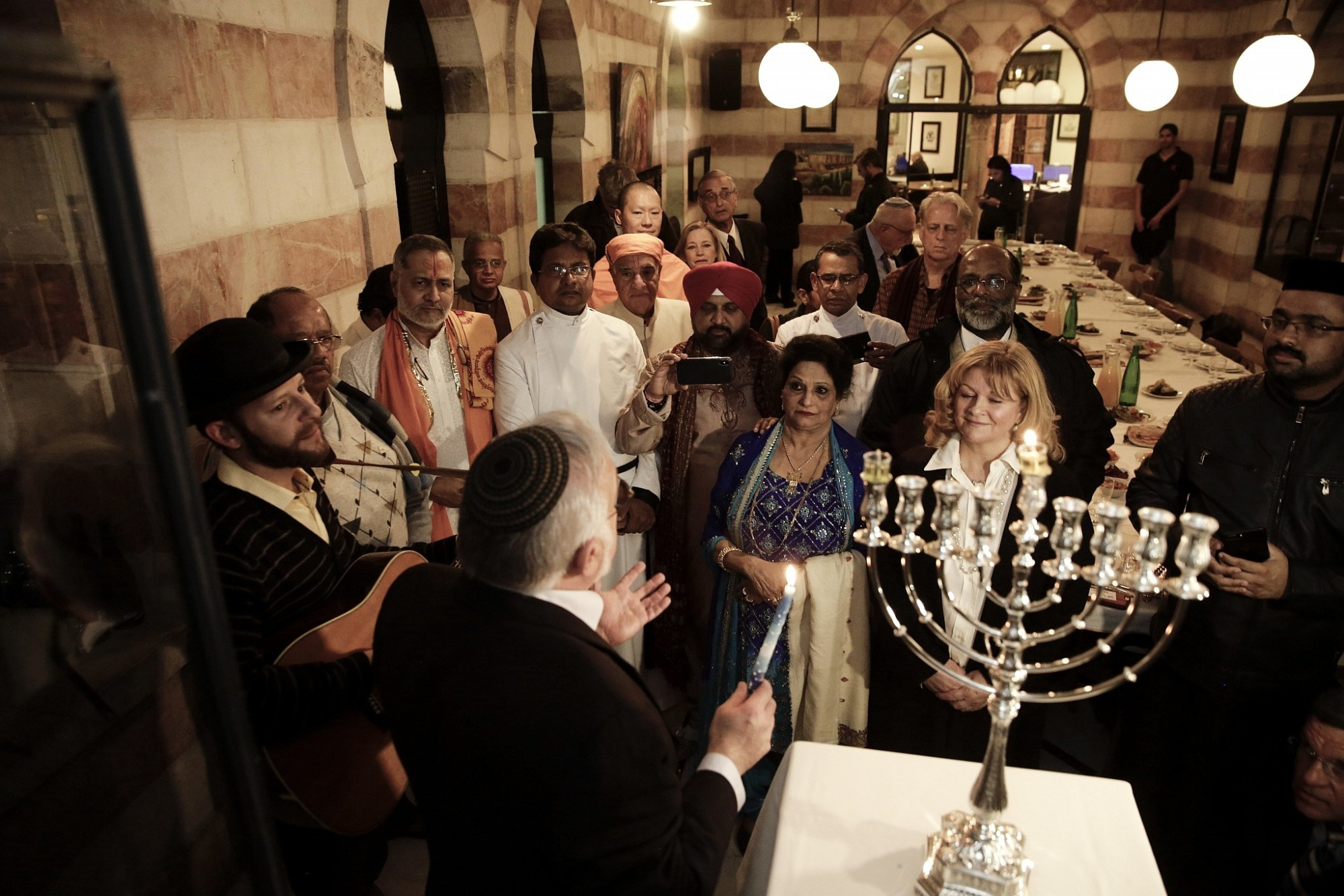 hight resolution of illustrative an interfaith group from the gulf state of bahrain attends hanukkah candle lighting in