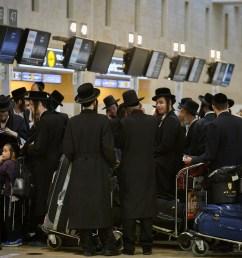 ultra orthodox jewish men traveling to uman in the ukraine for rosh hashanah seen [ 2048 x 1365 Pixel ]
