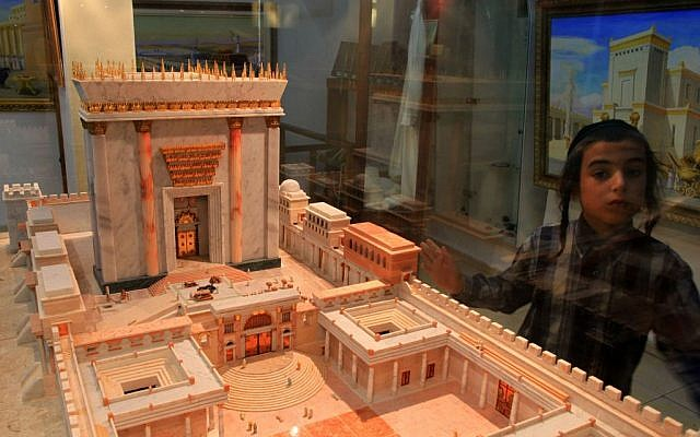 A young boy standing next to a model of the Second Temple at the Temple Insititute in Jerusalem. (photo credit: Nati Shohat/Flash90)
