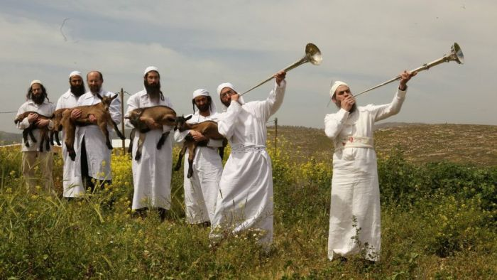Garbed in white and sounding silver trumpets, priests-in-training prepare for a practice Passover sacrifice. (Courtesy of The Temple Institute)