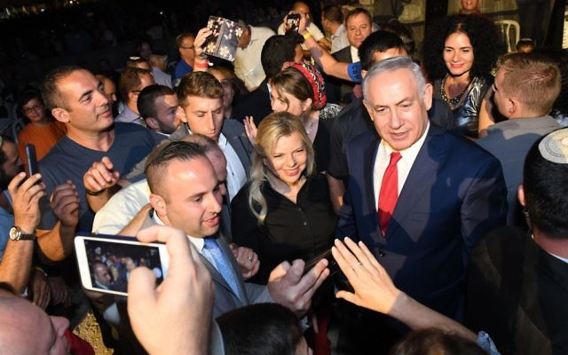 Prime Minister Benjamin Netanyahu and his wife Sara attend an event marking 50 years of Israeli settlements in Samaria, in Barkan, in the West Bank, on August 28, 2017. (Kobi Gideon/GPO)