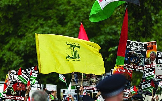 hezbollah flags to fly
