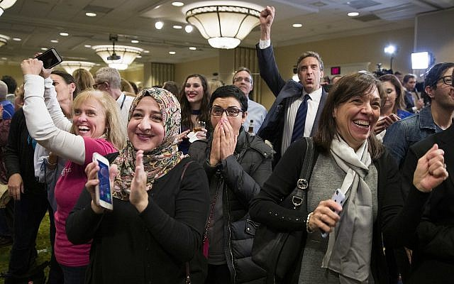 Supporters cheer as they watch returns at an election night party for Democrat congressional candidate Jennifer Wexton, Tuesday, November 6, 2018, in Dulles, Virginia. (AP Photo/Alex Brandon)