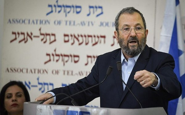 Former Prime Minister Ehud Barak (c) announces the formation of a new party at Tel Aviv's Beit Sokolov on June 26, 2019. (Jacob Magid/Times of Israel)