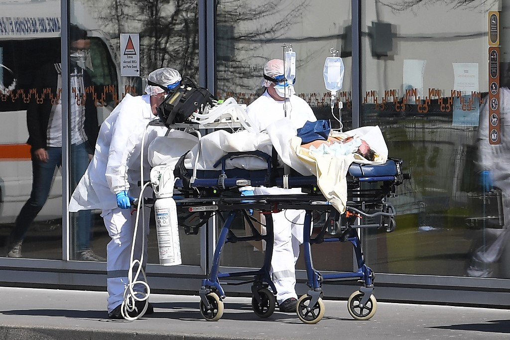Millions under lockdown as global COVID-19 death toll hits 6,513 ...