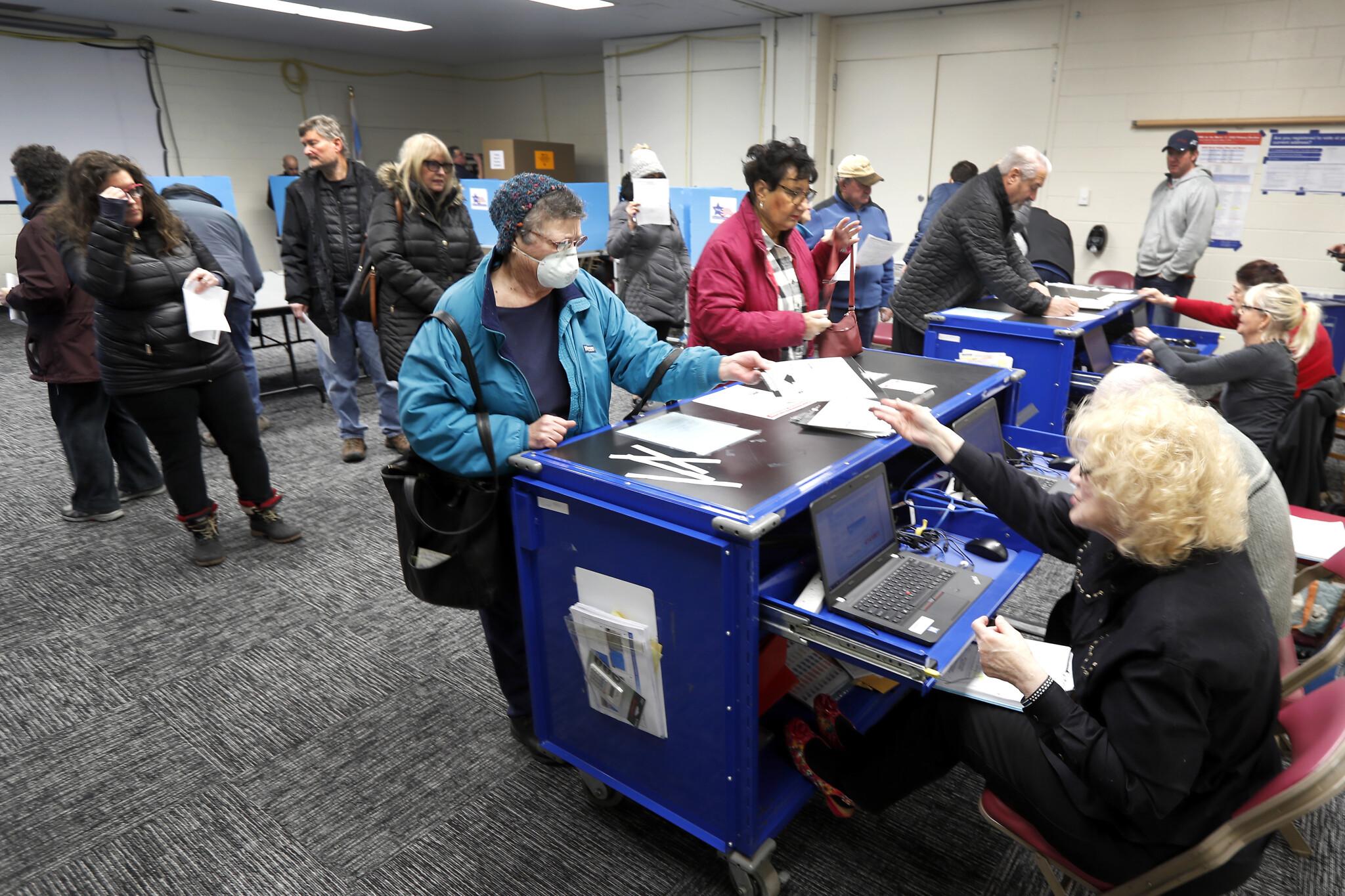 Biden wins Florida, Illinois as coronavirus disrupts voting | The ...