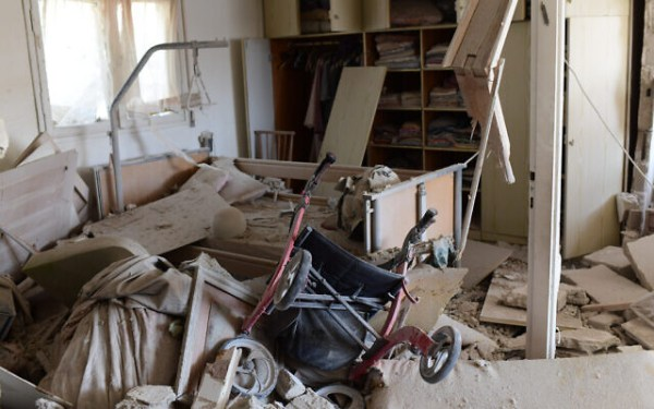 The scene where a rocket fired from the Gaza Strip hit a house in the southern Israeli city of Ashkelon on May 11, 2021. (Tomer Neuberg/Flash90)