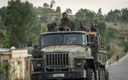 Ethiopian government soldiers ride in the back of a truck on a road leading to Abi Adi, in the Tigray region of northern Ethiopia Tuesday, May 11, 2021. (AP Photo/Ben Curtis)