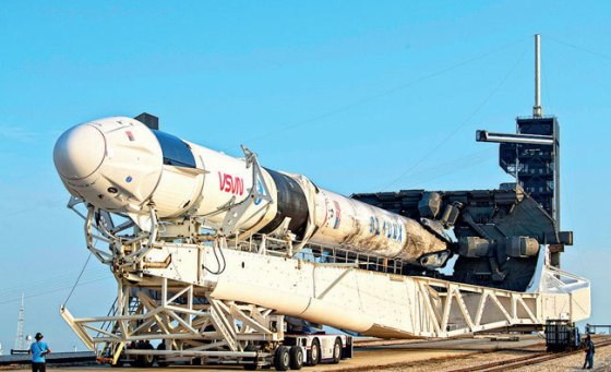A SpaceX Falcon 9 rocket with the company's Crew Dragon spacecraft is rolled to Launch Complex 39A as preparations continue for Crew-2's mission at NASA's Kennedy Space Center in Cape Canaveral, Florida;  PIC: AUBREY GEMIGNANI / NASA VIA AP