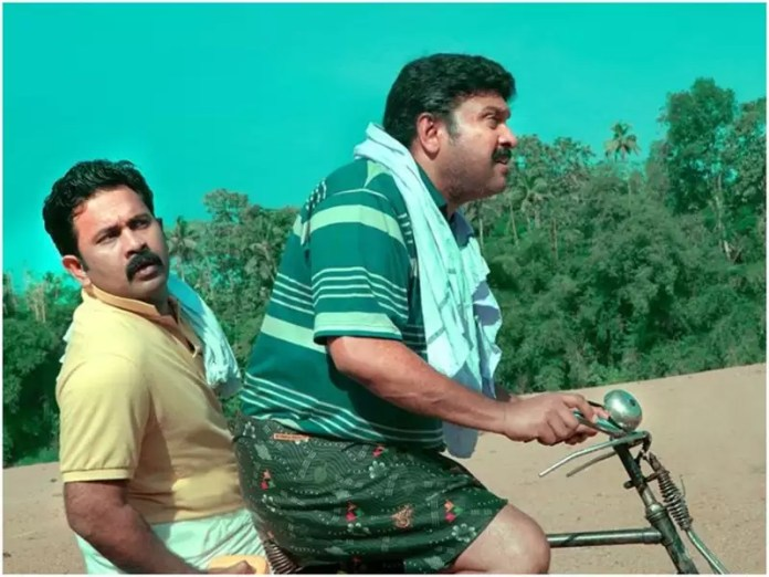 Sajan Bakery Since 1962 first look: 'Sajan Bakery Since 1962' first look:  Aju Varghese and Ganesh head to bathe in Pamba river | Malayalam Movie News  - Times of India