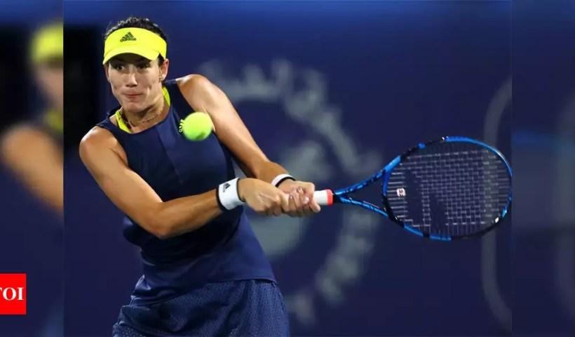 Muguruza defeats battling Mertens to reach Dubai final   Tennis News – Times of India