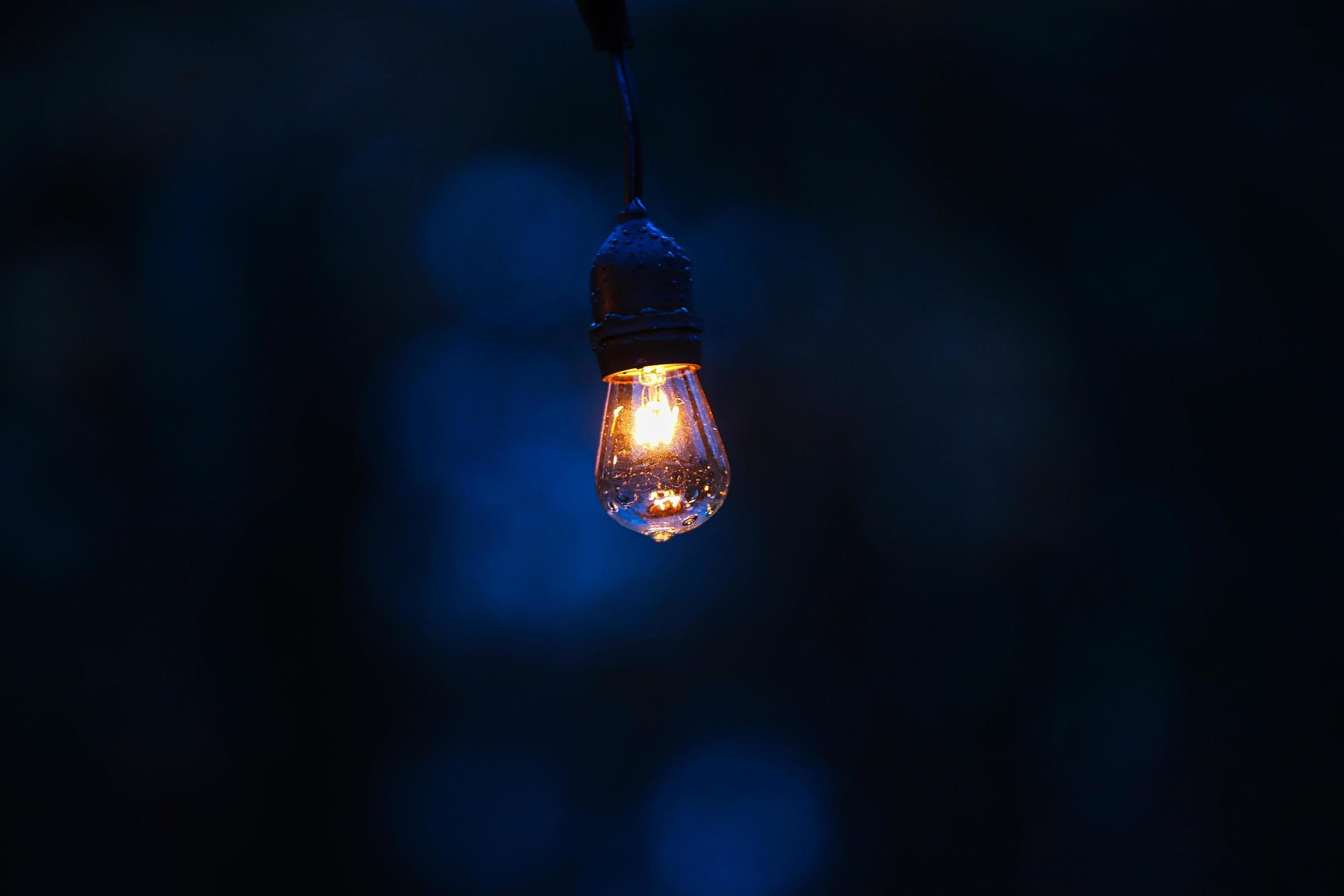 vintage light bulb in dark room 1248253