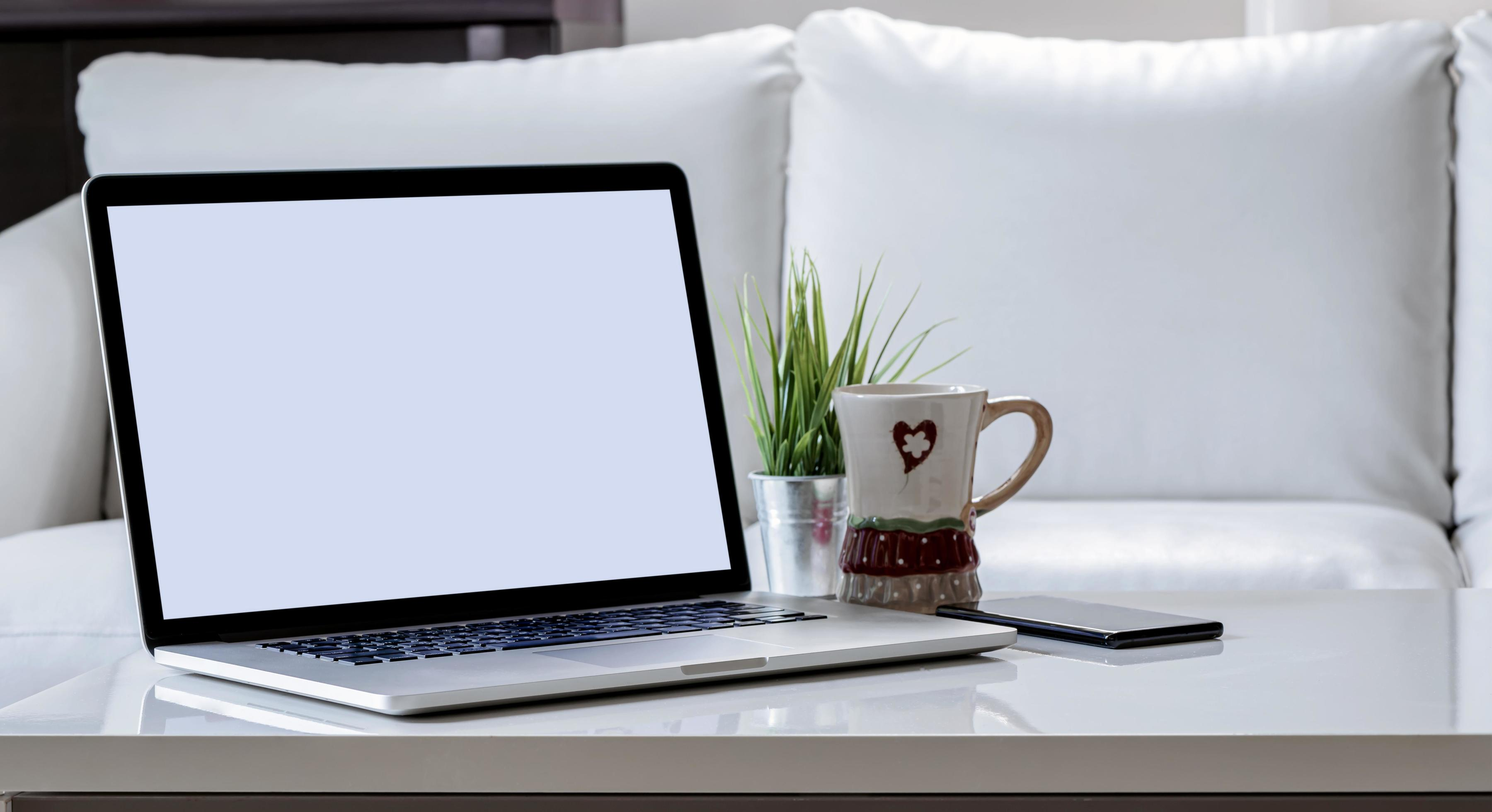 laptop mockup on a coffee table stock photo