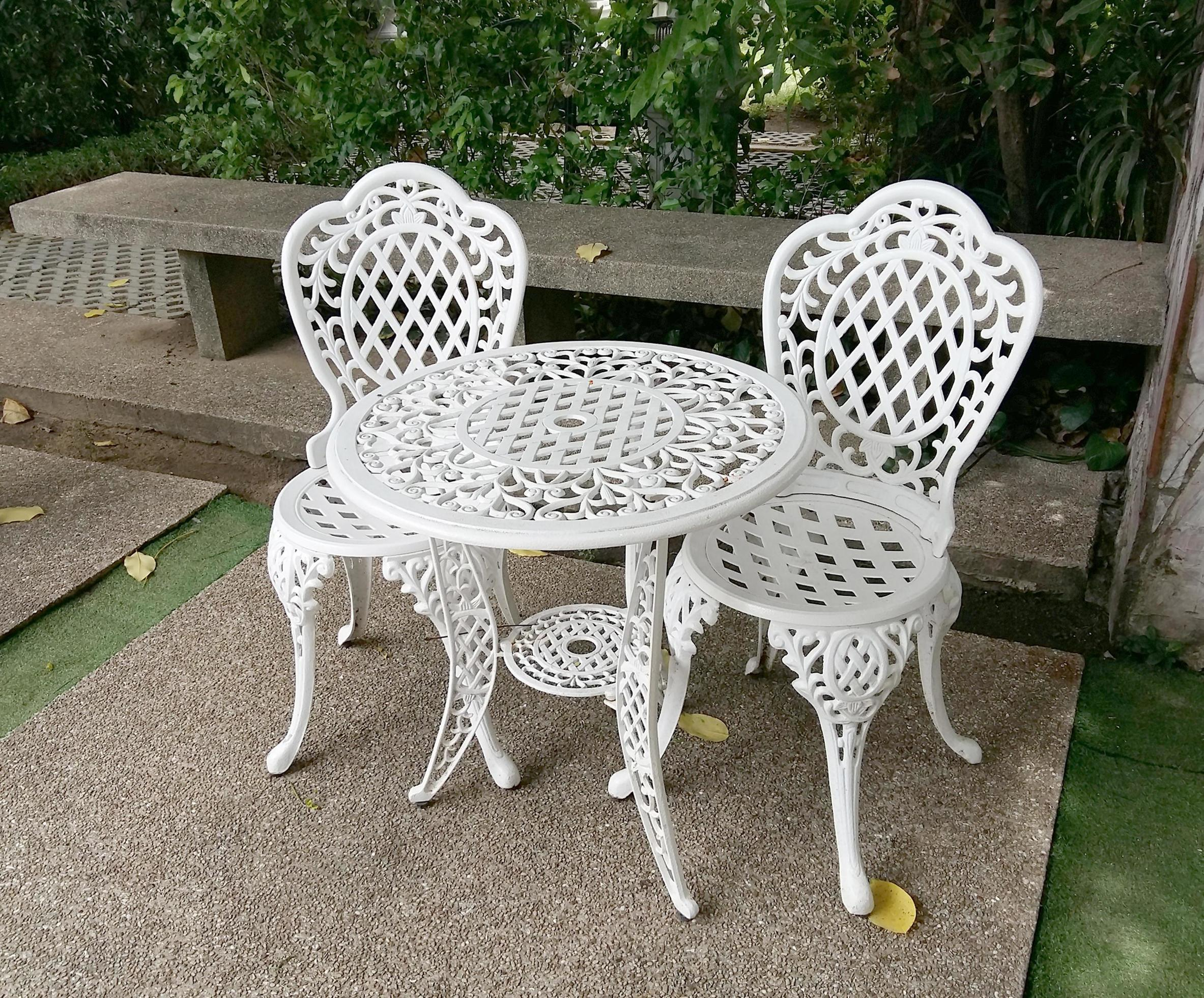 white metal chairs and table 1995860