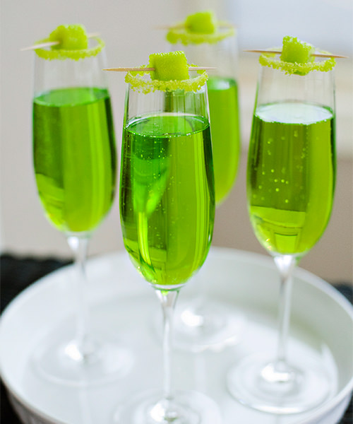 Sparkling Shamrock cocktail for St. Patrick's Day cocktail party with champagne and midori