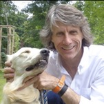 Terry Kyle in a passport photo holding his dog by the neck