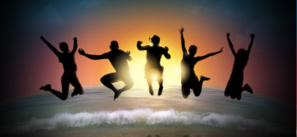 Happy People Silhouettes Jumping at the Sunset